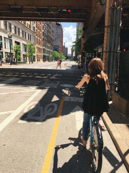 Pedaling down Dearborn Street.